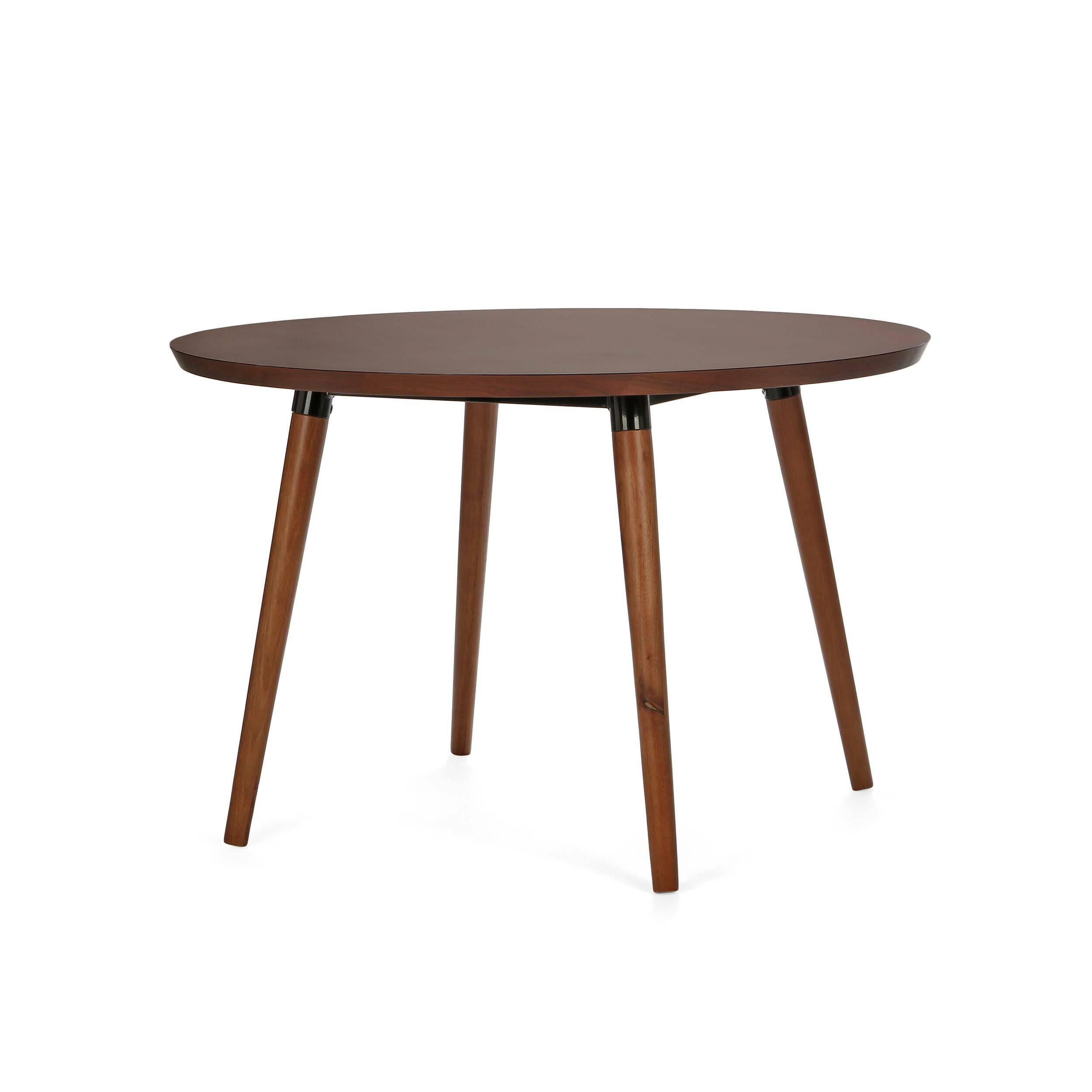 Обеденный стол Copine круглыйОбеденные<br>Крупный стол Copine круглый — актуальное решение для просторных кухонь больших семей. За его круглой столешницей могут свободно уместиться до пяти человек, что очень удобно для тех, кто любит принимать гостей. Его современный дизайн в стиле датский модерн обязательно придется по вкусу всем, кто действительно разбирается в дизайне и ценит простой семейный уют. <br><br><br> Благодаря темной столешнице, изделие отлично смотрится в интерьере с любым основным цветом. В зависимости от него, стол выг...<br><br>stock: 0<br>Высота: 75<br>Диаметр: 120<br>Материал каркаса: Массив ореха<br>Тип материала каркаса: Дерево<br>Цвет каркаса: Орех американский