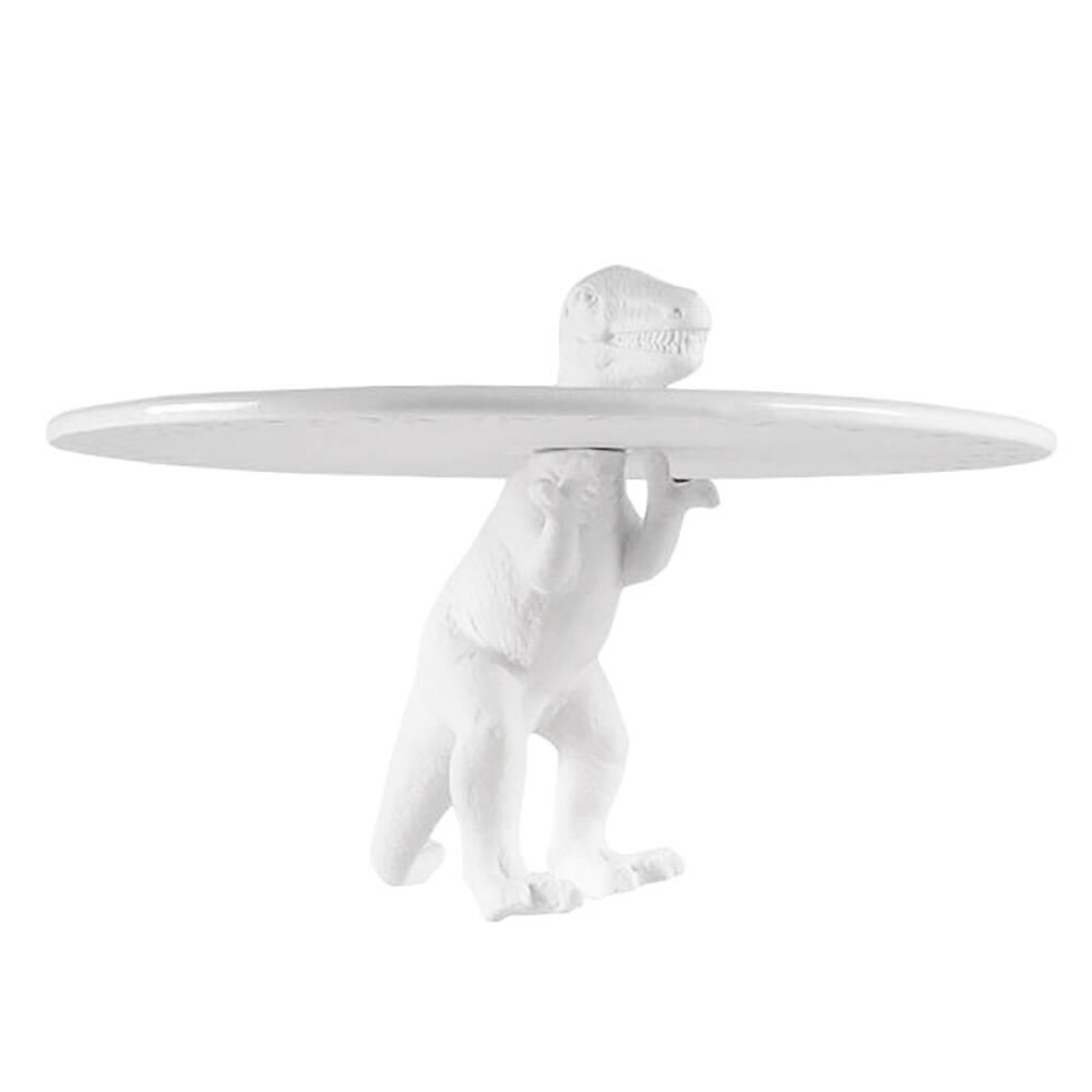 Подставка для торта Sauria T-RexПосуда<br>В нашу современную и суматошную эпоху порой так необходим источник настроения и позитивного настроя на будущее. А вот компания Seletti в этом просто уверена, поэтому предлагает коллекцию подставок под торты Sauria. Подставка для торта Sauria T-Rex —одна из них. <br> <br> Seletti давно слывут большими шутниками по части дизайна, но они никогда не пресекают тонкую грань между красотой и безвкусицей. <br> Эти чудные динозаврики с радостью украсят вашу кухню и будут приносить хорошее настроение 365 дне...<br><br>stock: 0<br>Высота: 8,5<br>Материал: Фарфор<br>Диаметр: 18,5
