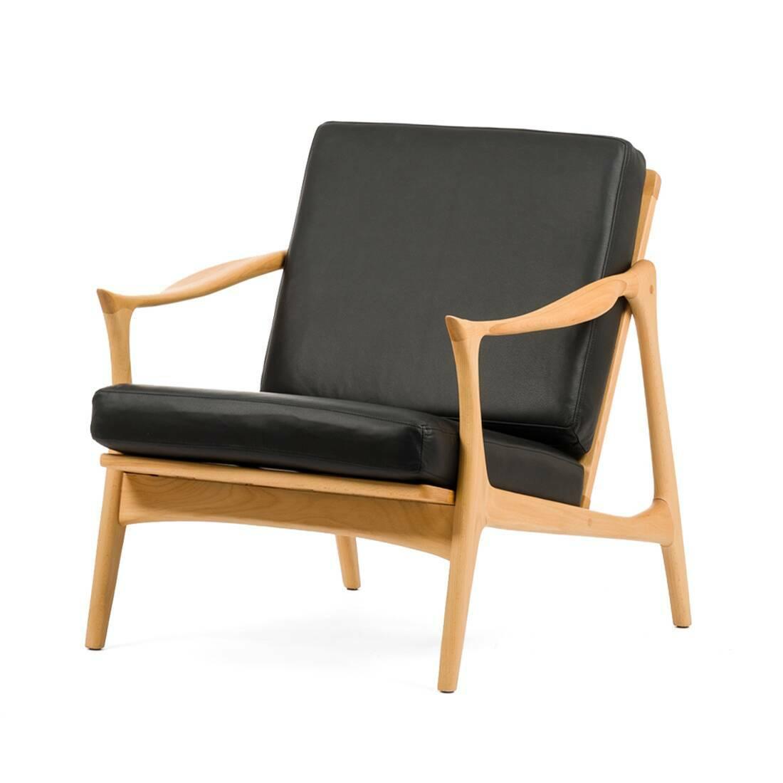 Кресло Model 711Интерьерные<br>Дизайнерское легкое мягкое кресло Model 711 (Модель 711) с деревянным каркасом от Cosmo (Космо).<br><br><br> Мебель Фредрика Кайзера яркая и функциональная, современная и легкая. Скандинавские черты в его работах перекликаются с необыкновенно красивой классикой и естественными линиями форм.<br><br><br> Именно таким является и кресло Model 711. Бук, использованный при создании этого кресла, обладает высоким качеством и прочностью древесины и ценится производителями мебели во всем мире. Деревянный карк...<br><br>stock: 1<br>Высота: 77<br>Высота сиденья: 39,5<br>Ширина: 71<br>Глубина: 81<br>Материал каркаса: Массив бука<br>Тип материала каркаса: Дерево<br>Коллекция ткани: Standart Leather<br>Тип материала обивки: Кожа<br>Цвет обивки: Черный<br>Цвет каркаса: Светло-коричневый