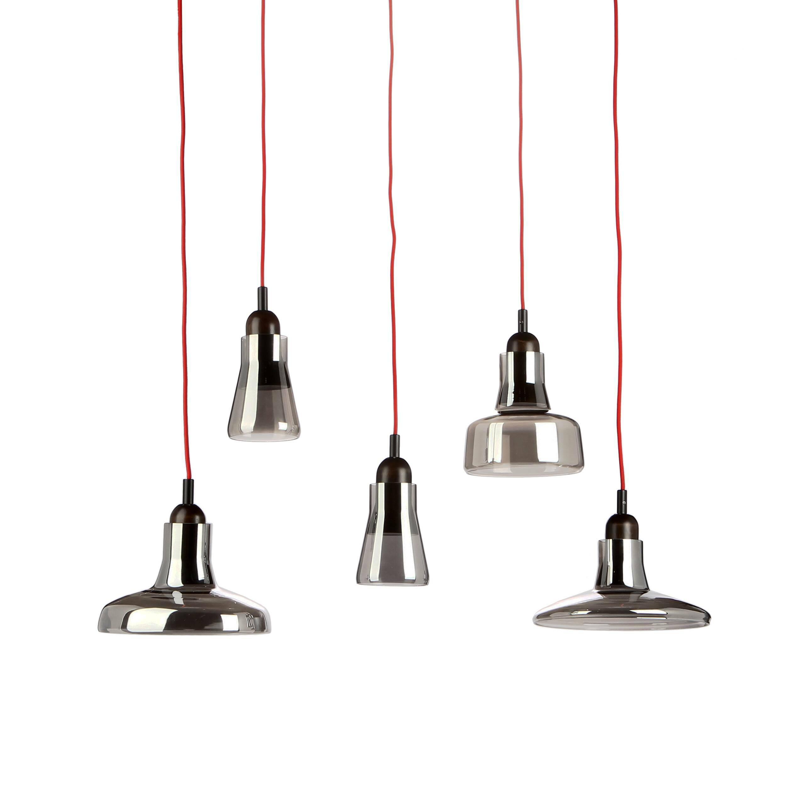 Подвесной светильник ShadowsПодвесные<br>Подвесной светильник Shadows — это тот дизайн, который приятно вас удивит. Минималистичность в деталях — одно из главных преимуществ светильника. При этом он весьма необычен, каждый абажур является частью отдельного светильника. <br><br><br> Изделие отлично подходит для помещений с высокими потолками. Использовать его можно в лофт-интерьере — для него он подходит и конструкцией, и дизайном. Лофт любит приглушенные цвета, простой дизайн и материалы природного происхождения. По этим и многим друг...<br><br>stock: 1<br>Высота: 200<br>Диаметр: 100<br>Количество ламп: 5<br>Материал абажура: Стекло<br>Материал арматуры: Дерево<br>Мощность лампы: 4<br>Ламп в комплекте: Нет<br>Напряжение: 220<br>Тип лампы/цоколь: LED<br>Цвет абажура: Серый
