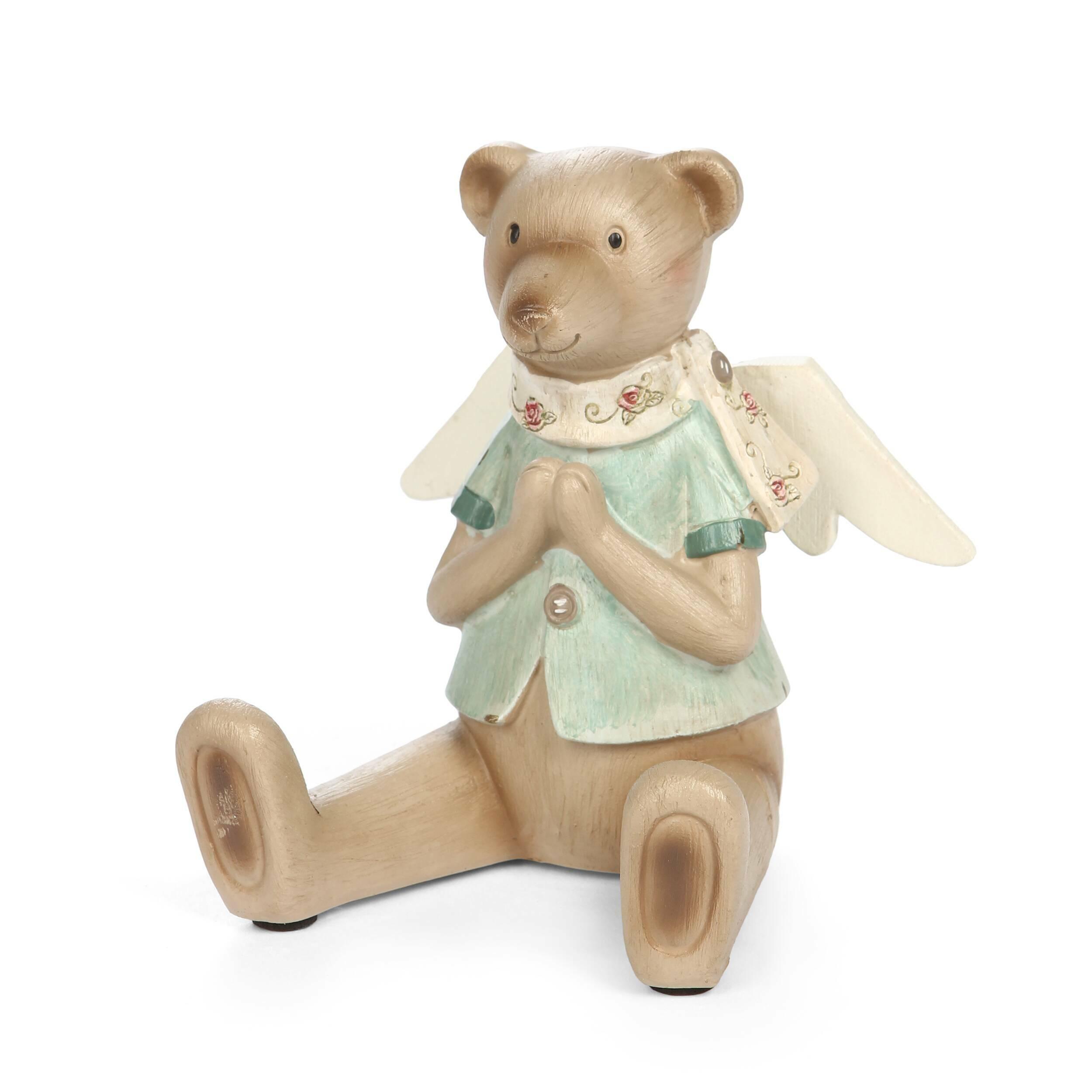 Статуэтка Angel TeddyНастольные<br>Дизайнерская светло-коричневая статуэтка Angel Teddy (Ангел Тэдди) из смолы в форме мишки-ангела от Cosmo (Космо).<br><br><br> Декорирование интерьера так же важно, как и весь законченный ремонт. Комната без декора выглядит пустой и безжизненной. Попробуйте внести хотя бы небольшой элемент интерьерного украшения, и вы сразу увидите, как преобразится все помещение и улучшится домашняя атмосфера. В данном случае речь идет о добавлении в интерьер капельки романтики и тепла.<br><br><br> Статуэтка Angel Te...<br><br>stock: 3<br>Высота: 11.5<br>Ширина: 9.5<br>Материал: Смола<br>Цвет: Светло-коричневый<br>Длина: 10.5<br>Цвет дополнительный: Голубой