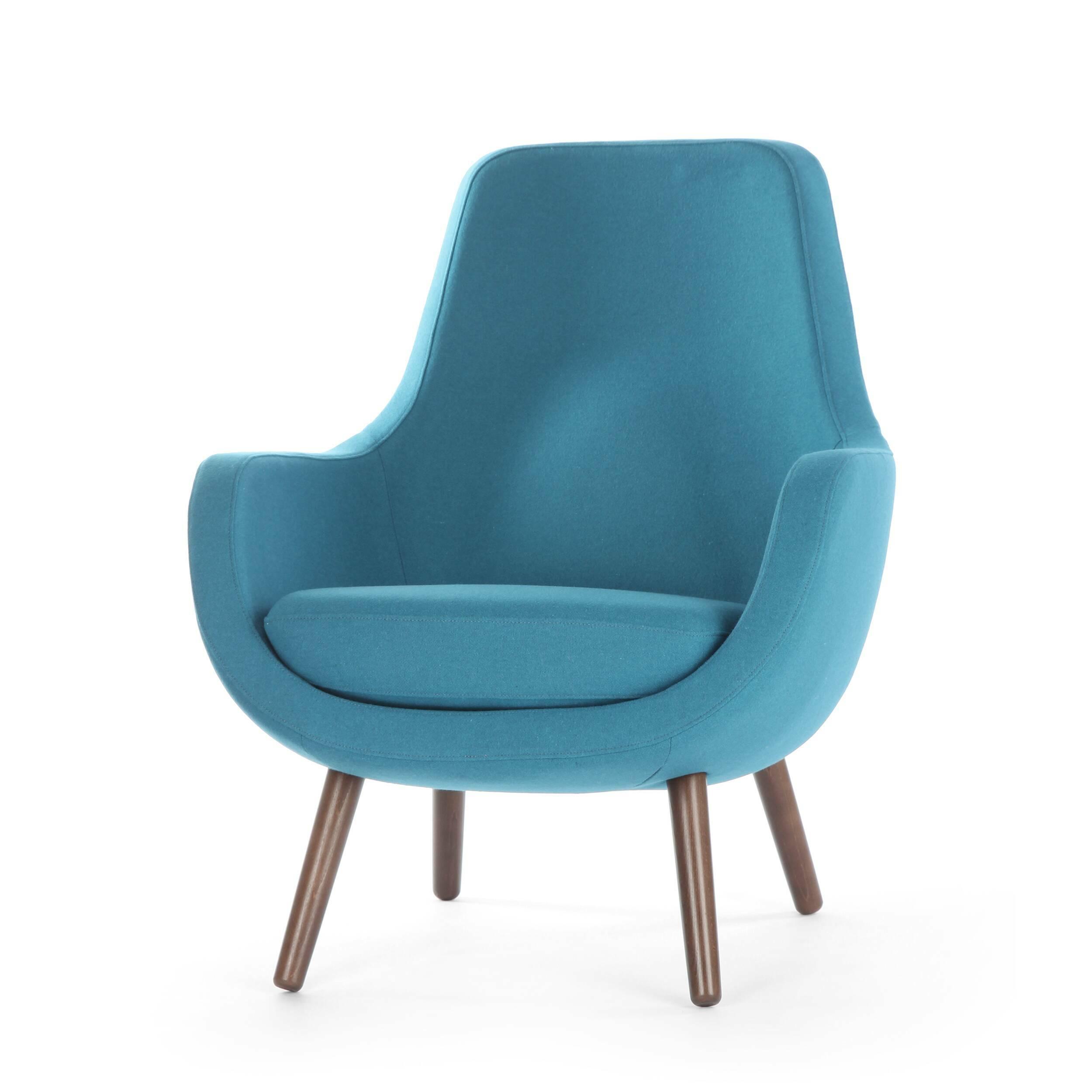 Кресло StefaniИнтерьерные<br>Дизайнерское яркое небольшое кресло Stefani (Стефани) на деревянных ножках от Sits (Ситс).<br><br>Нильс Гаммельгард — выдающийся датский дизайнер, сумевший найти свою нишу. Образованный и талантливый дизайнер вот уже 45 радует взыскательных любителей красивого интерьера. Как художнику ему удается создавать настоящие произведения искусства. Каждая его работа, предмет мебели, — это красивый и лаконичный дизайн, идеально подходящий для интерьера в скандинавском стиле.<br> <br> Один из его совершенных ...<br><br>stock: 0<br>Высота: 85<br>Высота сиденья: 42<br>Ширина: 73<br>Глубина: 77<br>Цвет ножек: Орех<br>Материал обивки: Шерсть, Полиамид<br>Степень комфортности: Стандарт комфорт<br>Форма подлокотников: Стандарт<br>Коллекция ткани: Категория ткани III<br>Тип материала обивки: Ткань<br>Тип материала ножек: Дерево<br>Цвет обивки: Бирюзовый