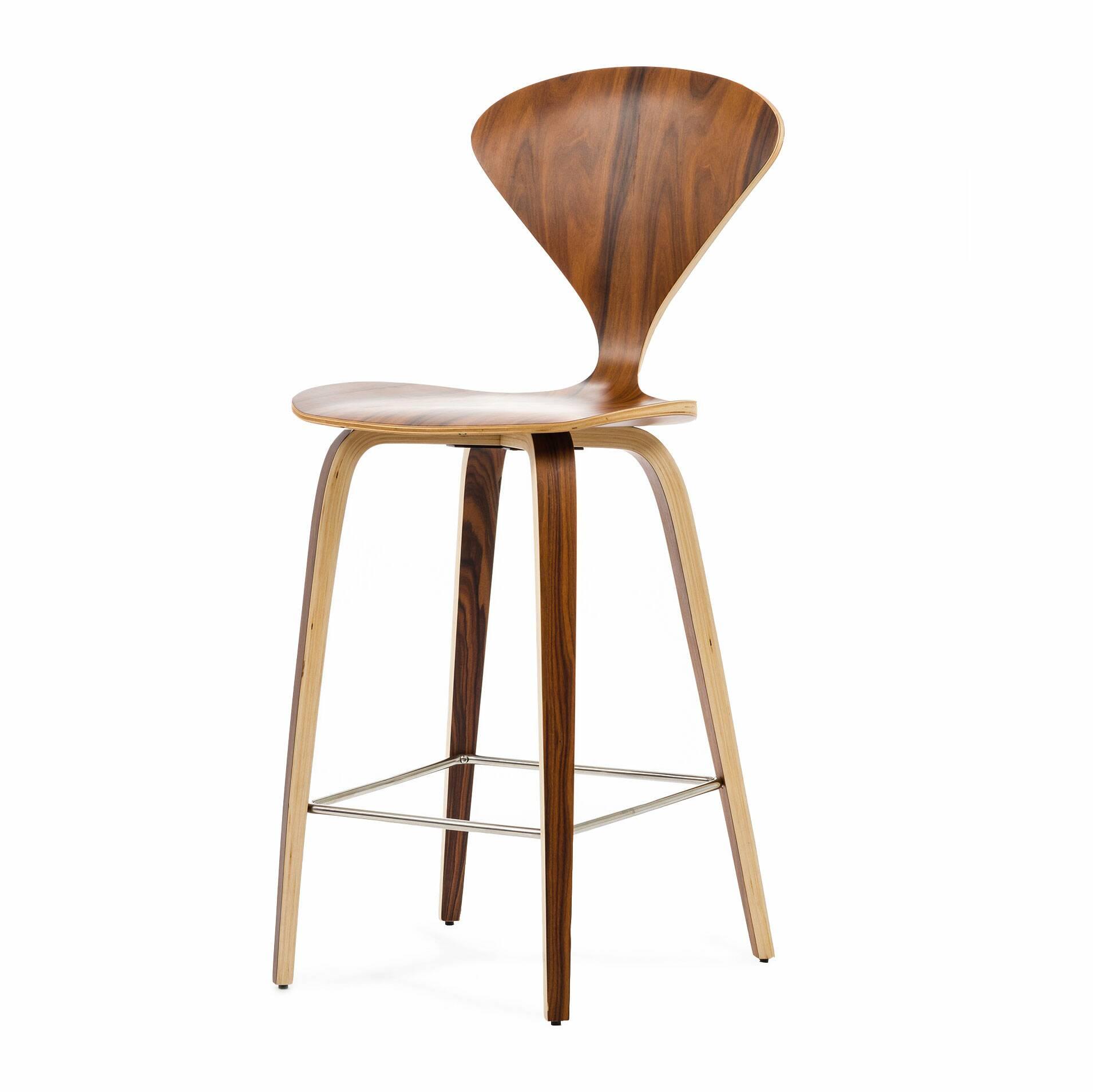 Барный стул Cherner высота 102Полубарные<br>Барный стул Cherner высота 102 — это великолепный деревянный барный стул 1958 года по-настоящему инновационного дизайна Нормана Чернера. Барный стул Cherner — прекрасный союз комфорта, новизны и стиля. Сам Норман Чернер был известным американским архитектором и дизайнером, он учился в Колумбийском университете, а затем и преподавал там, помимо этого он был консультантом MoMA, в тот период он вдохновился эстетикой баухауса и стал создавать собственные интерьеры и мебель, которые стали очень по...<br><br>stock: 0<br>Высота: 102,5<br>Высота сиденья: 65<br>Ширина: 47<br>Глубина: 51<br>Материал каркаса: Фанера, шпон розового дерева<br>Тип материала каркаса: Дерево<br>Цвет каркаса: Коричневый