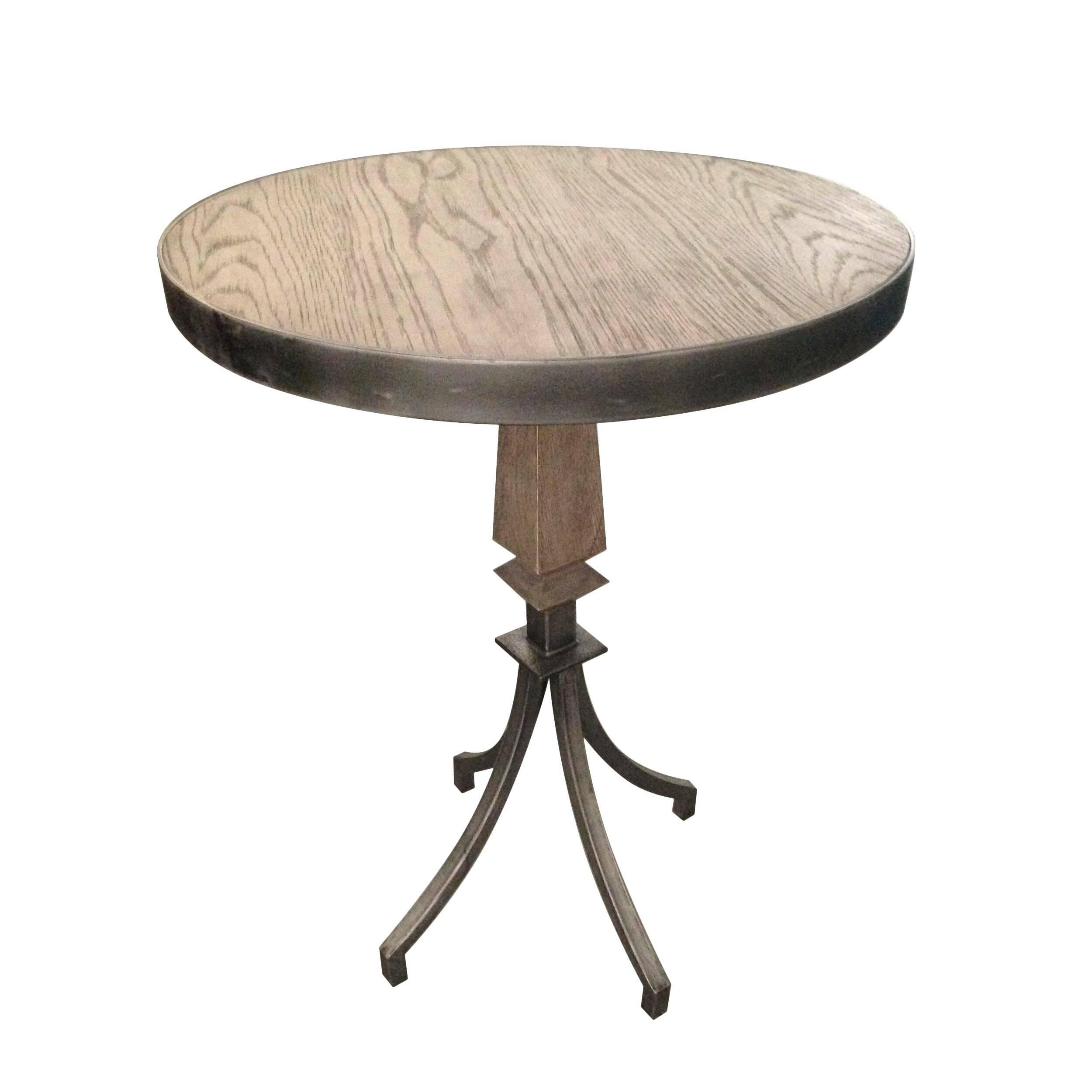 Кофейный стол Berkeley дубовыйКофейные столики<br>Кофейный стол Berkeley дубовый – это прекрасный образец мебели, сделанной под старину. От модели веет прекрасным духом рыцарских времен – нарочито грубоватый стиль и изящные черты заключены в прочную форму из дуба и металла.<br><br><br> Массив дуба – это благородный материал, который сочетает в себе самые ценные качества: прочность, экологичность, долговечность. Дубовая мебель способна на протяжении длительного времени радовать владельцев своим идеальным внешним видом. Столешница данной модели ...<br><br>stock: 0<br>Высота: 75<br>Диаметр: 55<br>Цвет столешницы: Темно-коричневый<br>Материал столешницы: Массив дуба<br>Тип материала каркаса: Металл<br>Тип материала столешницы: Дерево<br>Цвет каркаса: Темно-серый