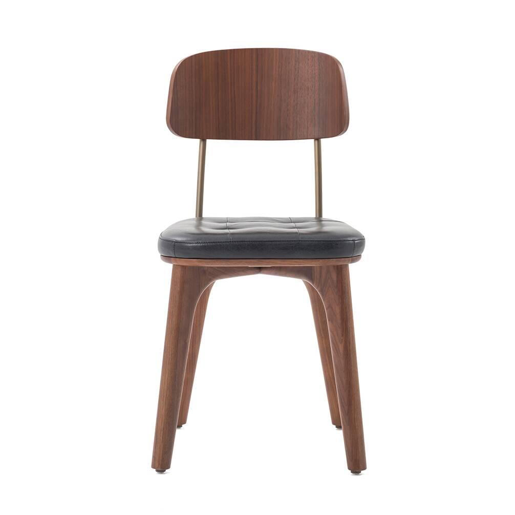 Стул Utility с кожаным сиденьемИнтерьерные<br>Стул Utility с кожаным сиденьем – это универсальное и очень красивое изделие, созданное талантливыми дизайнерами и мастерами компании Stellar Works. Каждое их творение способно привнести что-то новое в домашний интерьер, создать совершенно неповторимую атмосферу, сделать его более красивым, удобным и стильным. И конечно, функциональным – ведь именно функциональность часто является одним из главных критериев подбора стульев для домашнего интерьера.<br><br><br> Стул Utility с кожаным сиденьем не т...<br><br>stock: 0<br>Высота: 81<br>Высота сиденья: 46,6<br>Ширина: 42,1<br>Глубина: 51,1<br>Цвет ножек: Орех<br>Цвет спинки: Латунь<br>Материал ножек: Массив ясеня<br>Цвет сидения: Черный<br>Тип материала спинки: Сталь<br>Тип материала сидения: Кожа<br>Коллекция ткани: CARESS<br>Тип материала ножек: Дерево