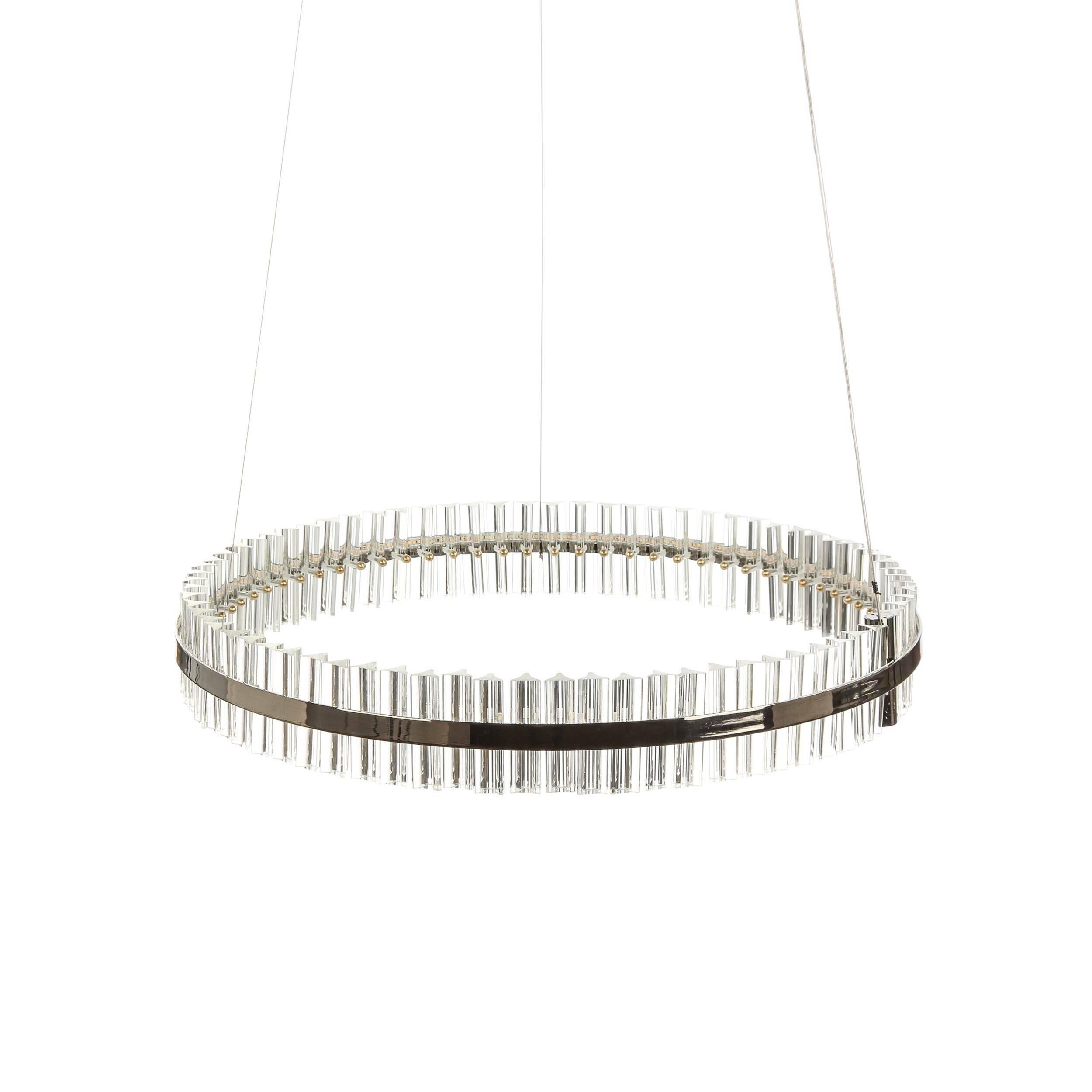 Подвесной светильник ElvenПодвесные<br>Необычный дизайнерский подвесной светильник Elven (Элвен) представляет собой широкий обод из хрусталя. Хрустальными люстрами украшают самые роскошные и пышные помещения. Это изделие ярко выделяется среди других светильников из хрусталя, в нем гармонично сошлись классика и самые современные тренды в дизайнерском искусстве – лофт, минимализм, функциональность.<br><br><br> Кроме хрустальных элементов, для создания этого изделия также используется сталь и алюминий – для надежности креплений и проч...<br><br>stock: 5<br>Высота: 11<br>Диаметр: 78<br>Материал абажура: Хрусталь<br>Материал арматуры: Сталь, Алюминий<br>Мощность лампы: 30<br>Тип лампы/цоколь: LED<br>Цвет абажура: Черный<br>Цвет арматуры: Черный