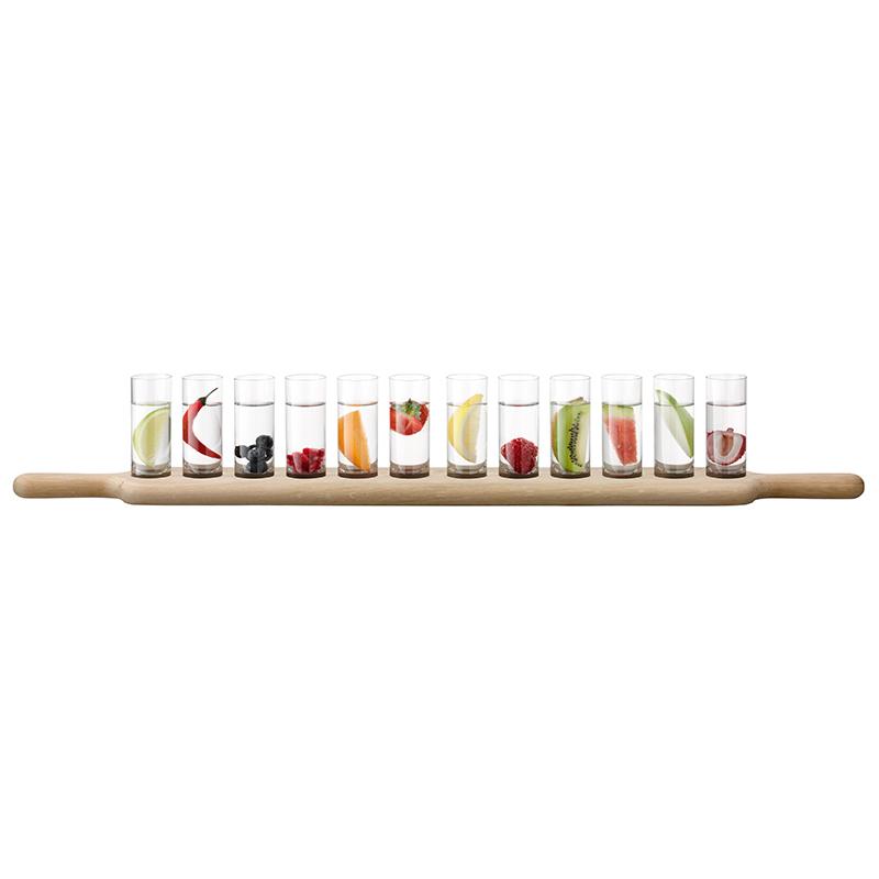 Набор рюмок для водки на подставке PADDLE (G1078-03-301)Посуда<br>Артикул: G1078-03-301. Если вам по душе оригинальная барная подача напитков, вы оцените стильный набор рюмок для водки PADDLE. Эти аксессуары из прозрачного стекла отличаются грациозной стройностью, благодаря чему ваши коктейли обретут новую, непривычную форму. Длинная и тонкая дубовая подставка позволяет подать сразу все шоты в любой уголок вашего дома, что незаменимо для большой компании. Такая группа отлично смотрится на барной стойке или столешнице в современной кухне или столовой, подчер...<br><br>stock: 14<br>Материал: стекло, дерево<br>Цвет: Белый<br>Размер: 77<br>Длина: 77<br>Страна происхождения: Великобритания