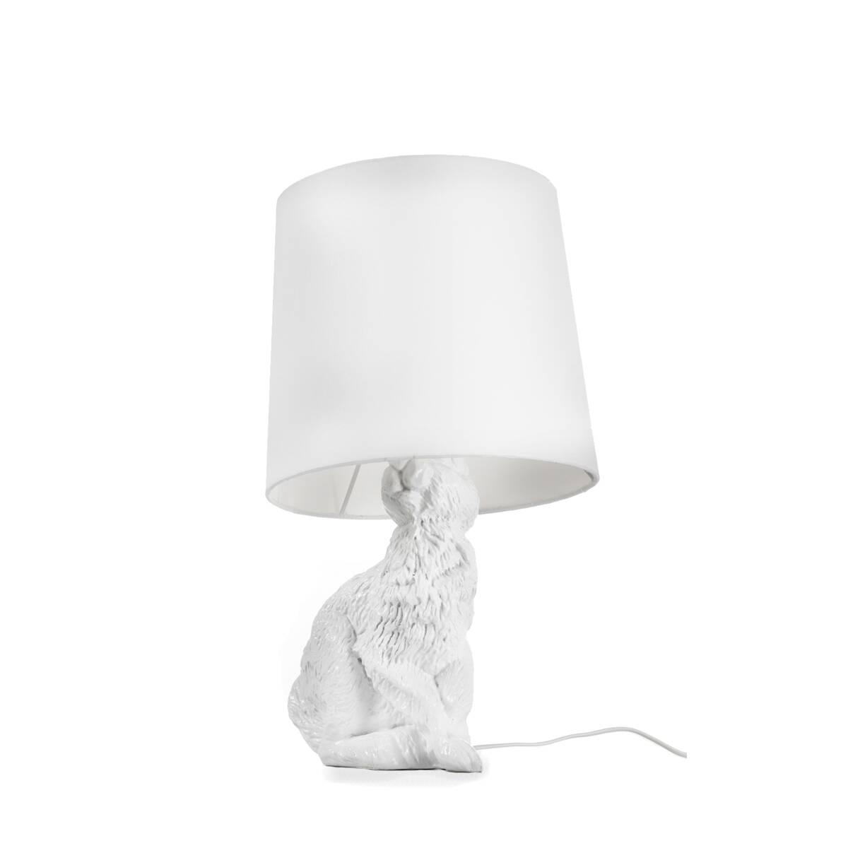 Настольный светильник RabbitНастольные<br>Дизайнерский настольный светильник Rabbit (Рэббит) в форме кролика от Cosmo (Космо).<br><br> Привнесите в ваш интерьер нотку юмора! Забавный, причудливый, но при этом очень практичный настольный светильник Rabbit оживит любую комнату. Пластиковое основание светильника выполнено в форме милого зверька кролика, который словно спрятался и замер под абажуром. Найдут или не найдут? Заметят или нет?<br><br><br> Светильник представляет собой воспроизведение работы шведской дизайнерской группы Front, котор...<br><br>stock: 0<br>Высота: 54<br>Диаметр: 29<br>Количество ламп: 1<br>Материал абажура: Ткань<br>Материал арматуры: Пластик<br>Ламп в комплекте: Нет<br>Напряжение: 220<br>Тип лампы/цоколь: E14<br>Цвет абажура: Белый<br>Цвет арматуры: Белый