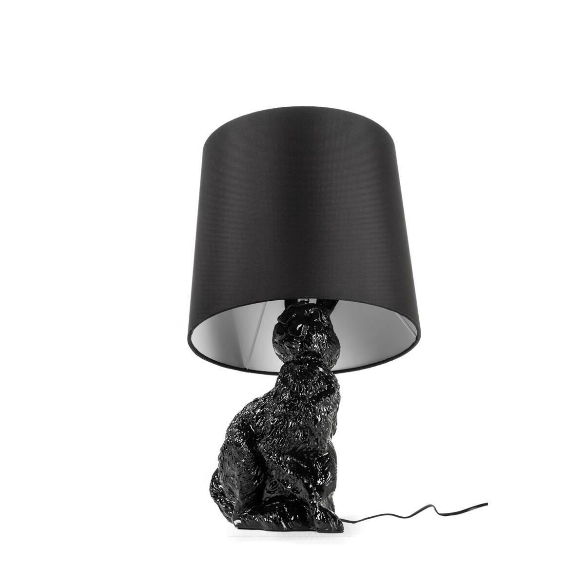 Настольный светильник RabbitНастольные<br>Дизайнерский настольный светильник Rabbit (Рэббит) в форме кролика от Cosmo (Космо).<br><br> Привнесите в ваш интерьер нотку юмора! Забавный, причудливый, но при этом очень практичный настольный светильник Rabbit оживит любую комнату. Пластиковое основание светильника выполнено в форме милого зверька кролика, который словно спрятался и замер под абажуром. Найдут или не найдут? Заметят или нет?<br><br><br> Светильник представляет собой воспроизведение работы шведской дизайнерской группы Front, котор...<br><br>stock: 0<br>Высота: 54<br>Диаметр: 29<br>Количество ламп: 1<br>Материал абажура: Ткань<br>Материал арматуры: Пластик<br>Ламп в комплекте: Нет<br>Напряжение: 220<br>Тип лампы/цоколь: E14<br>Цвет абажура: Черный<br>Цвет арматуры: Черный