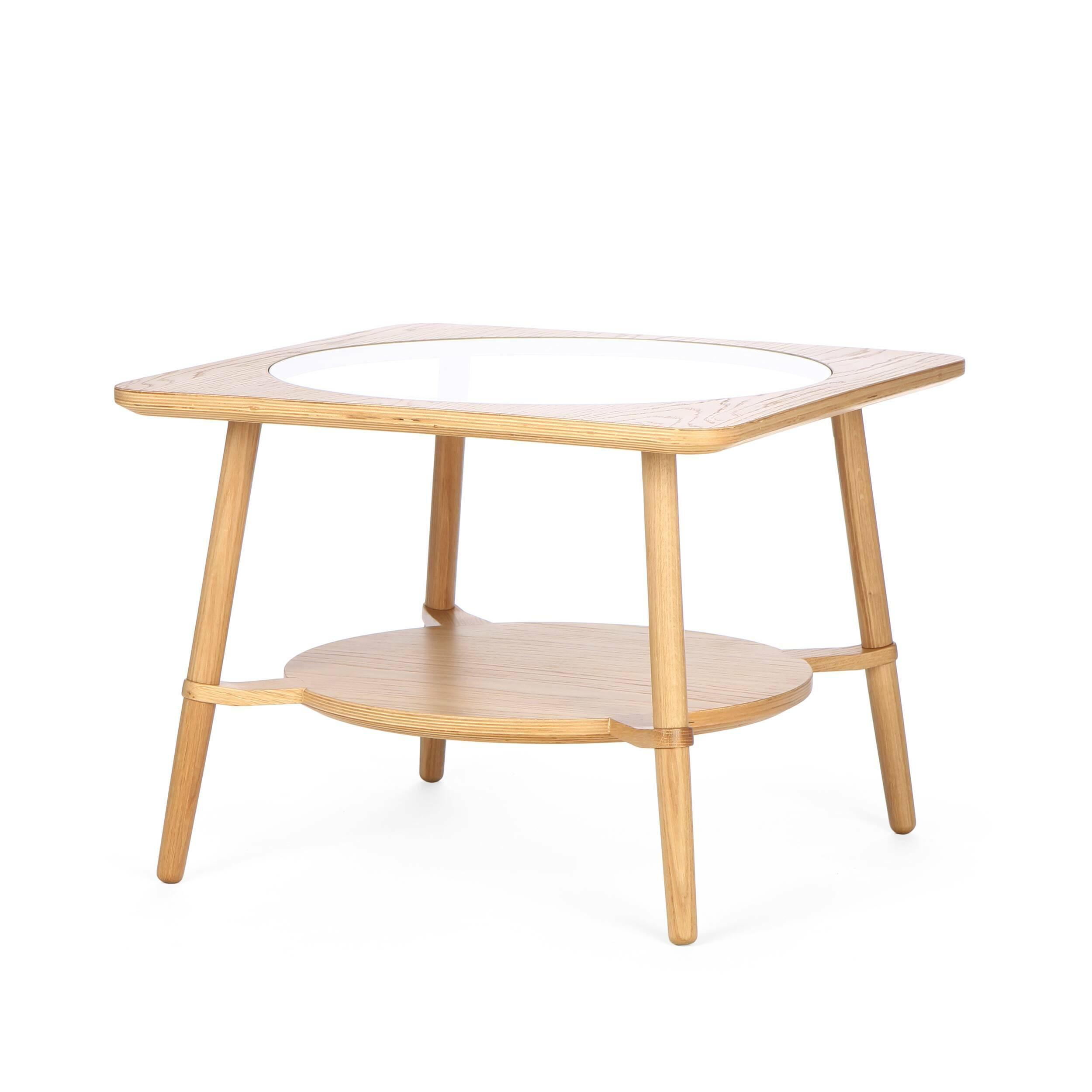 Кофейный стол  CutoutКофейные столики<br>Дизайнерский стильный кофейный стол Cutout (Катаут) с прозрачной столешницей от Cosmo (Космо).<br><br><br> Журнальный стол Cutout сконструировал американский дизайнер Шон Дикс. Мебель Шона Дикса минималистична и интеллектуальна, прекрасно обработана и очень функциональна. Она несет в себе чувство роскоши, которое отличает работы Шона от работ его коллег. <br><br><br> Иногда дизайнеры как дети, им хочется взяться за ножницы и клей и смастерить причудливое оригами или аппликацию. Так родилась и эта моде...<br><br>stock: 3<br>Высота: 45<br>Ширина: 60<br>Длина: 60<br>Цвет ножек: Светло-коричневый<br>Цвет столешницы: Прозрачный<br>Материал каркаса: Фанера, шпон дуба<br>Материал ножек: Массив дуба<br>Тип материала каркаса: Фанера<br>Тип материала столешницы: Стекло закаленное<br>Тип материала ножек: Дерево<br>Цвет каркаса: Светло-коричневый