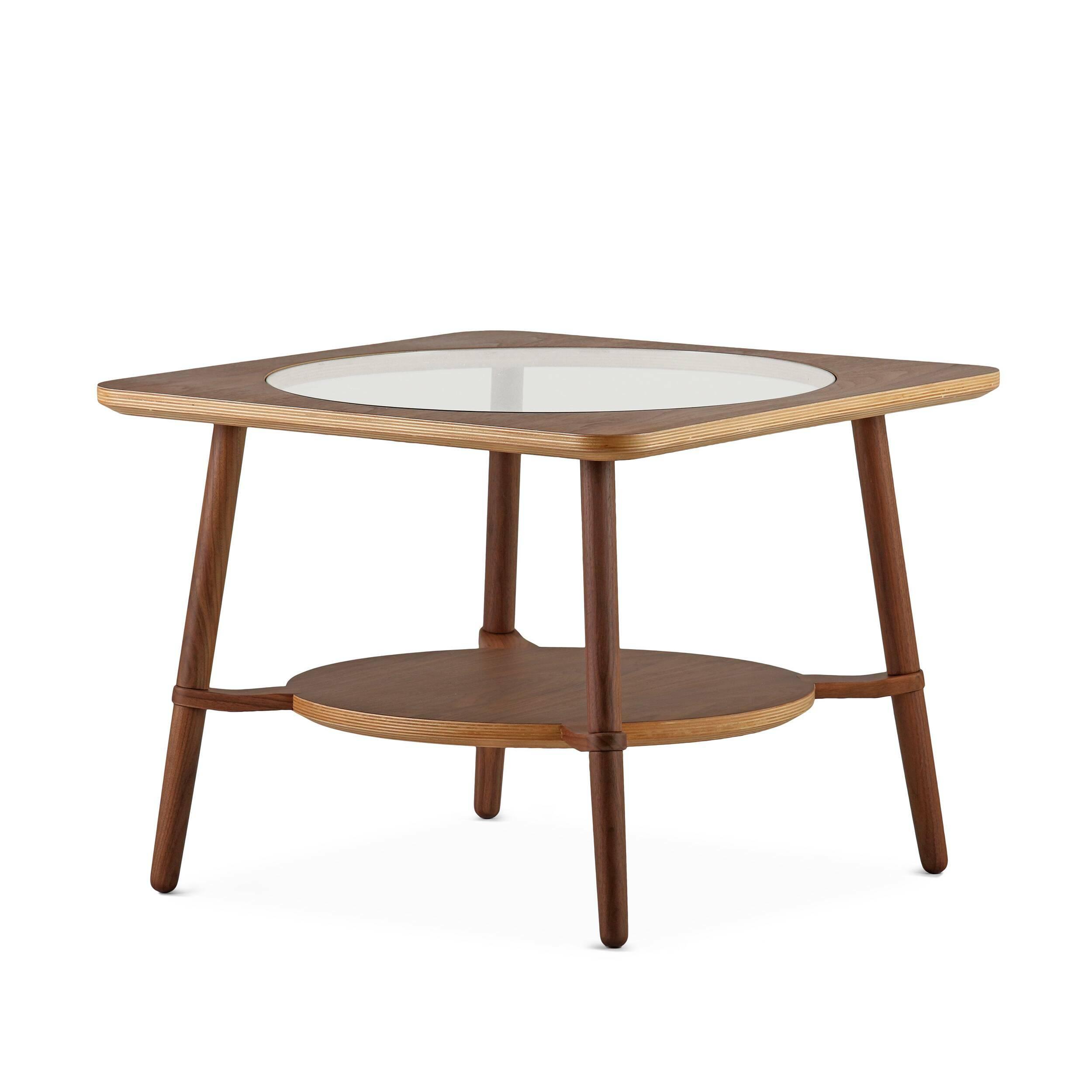 Кофейный стол  CutoutКофейные столики<br>Дизайнерский стильный кофейный стол Cutout (Катаут) с прозрачной столешницей от Cosmo (Космо).<br><br><br> Журнальный стол Cutout сконструировал американский дизайнер Шон Дикс. Мебель Шона Дикса минималистична и интеллектуальна, прекрасно обработана и очень функциональна. Она несет в себе чувство роскоши, которое отличает работы Шона от работ его коллег. <br><br><br> Иногда дизайнеры как дети, им хочется взяться за ножницы и клей и смастерить причудливое оригами или аппликацию. Так родилась и эта моде...<br><br>stock: 3<br>Высота: 45<br>Ширина: 60<br>Длина: 60<br>Цвет ножек: Орех американский<br>Цвет столешницы: Прозрачный<br>Материал каркаса: Фанера, шпон ореха<br>Материал ножек: Массив ореха<br>Тип материала каркаса: Фанера<br>Тип материала столешницы: Стекло закаленное<br>Тип материала ножек: Дерево<br>Цвет каркаса: Орех американский
