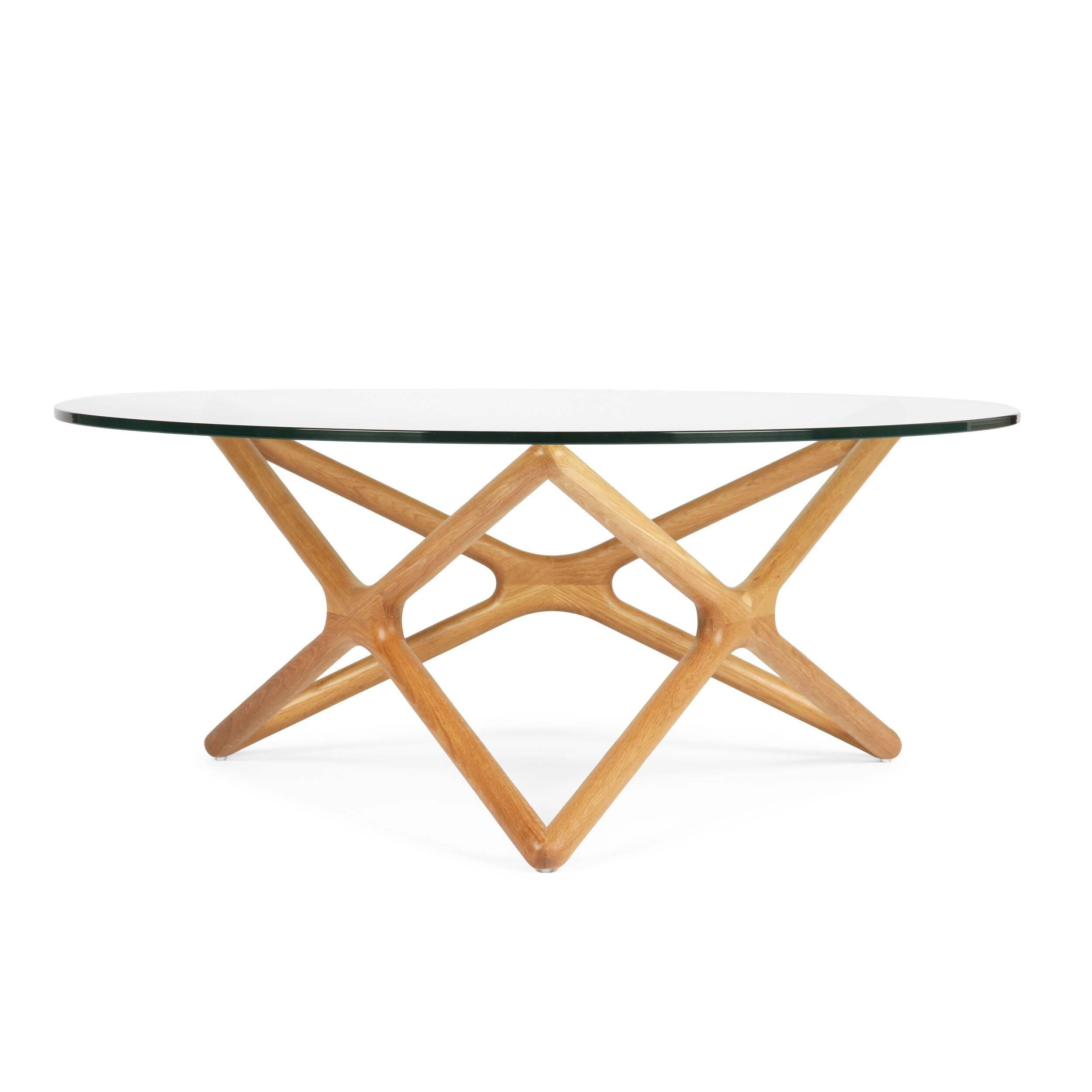Кофейный стол Triple X высота 41Кофейные столики<br>Дизайнерский широкий кофейный стол Triple X (Трипл Икс) с высотой 41 см со стеклянной столешницей от Cosmo (Космо).<br><br><br><br> Необычная геометрия стола влюбляет в себя с первого взгляда. Кажется, будто живая лиана оплетает стеклянную столешницу. В названии читается особенность конструкции стола. С английского Triple X — «три икс». Схема конструкции будто составлена из трех английских букв X, циклично соединенных между собой. Сверху же ножки выглядят как пятиконечная звезда. Если смотреть на с...<br><br>stock: 7<br>Высота: 41,2<br>Диаметр: 100<br>Цвет ножек: Светло-коричневый<br>Цвет столешницы: Прозрачный<br>Материал ножек: Массив дуба<br>Тип материала столешницы: Стекло закаленное<br>Тип материала ножек: Дерево