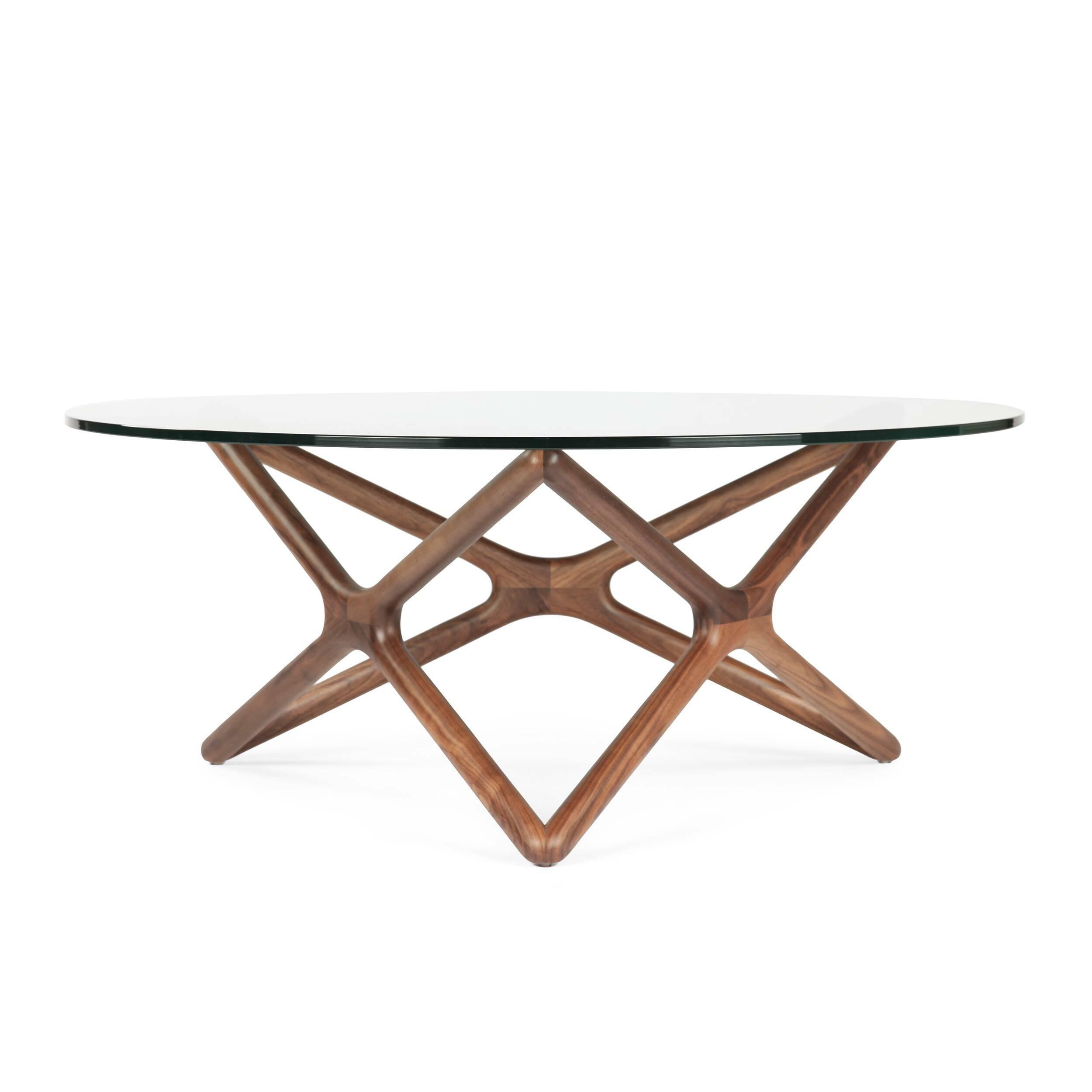 Кофейный стол Triple X высота 41Кофейные столики<br>Дизайнерский широкий кофейный стол Triple X (Трипл Икс) с высотой 41 см со стеклянной столешницей от Cosmo (Космо).<br><br><br><br> Необычная геометрия стола влюбляет в себя с первого взгляда. Кажется, будто живая лиана оплетает стеклянную столешницу. В названии читается особенность конструкции стола. С английского Triple X — «три икс». Схема конструкции будто составлена из трех английских букв X, циклично соединенных между собой. Сверху же ножки выглядят как пятиконечная звезда. Если смотреть на с...<br><br>stock: 5<br>Высота: 41,2<br>Диаметр: 100<br>Цвет ножек: Орех американский<br>Цвет столешницы: Прозрачный<br>Материал ножек: Массив ореха<br>Тип материала столешницы: Стекло закаленное<br>Тип материала ножек: Дерево