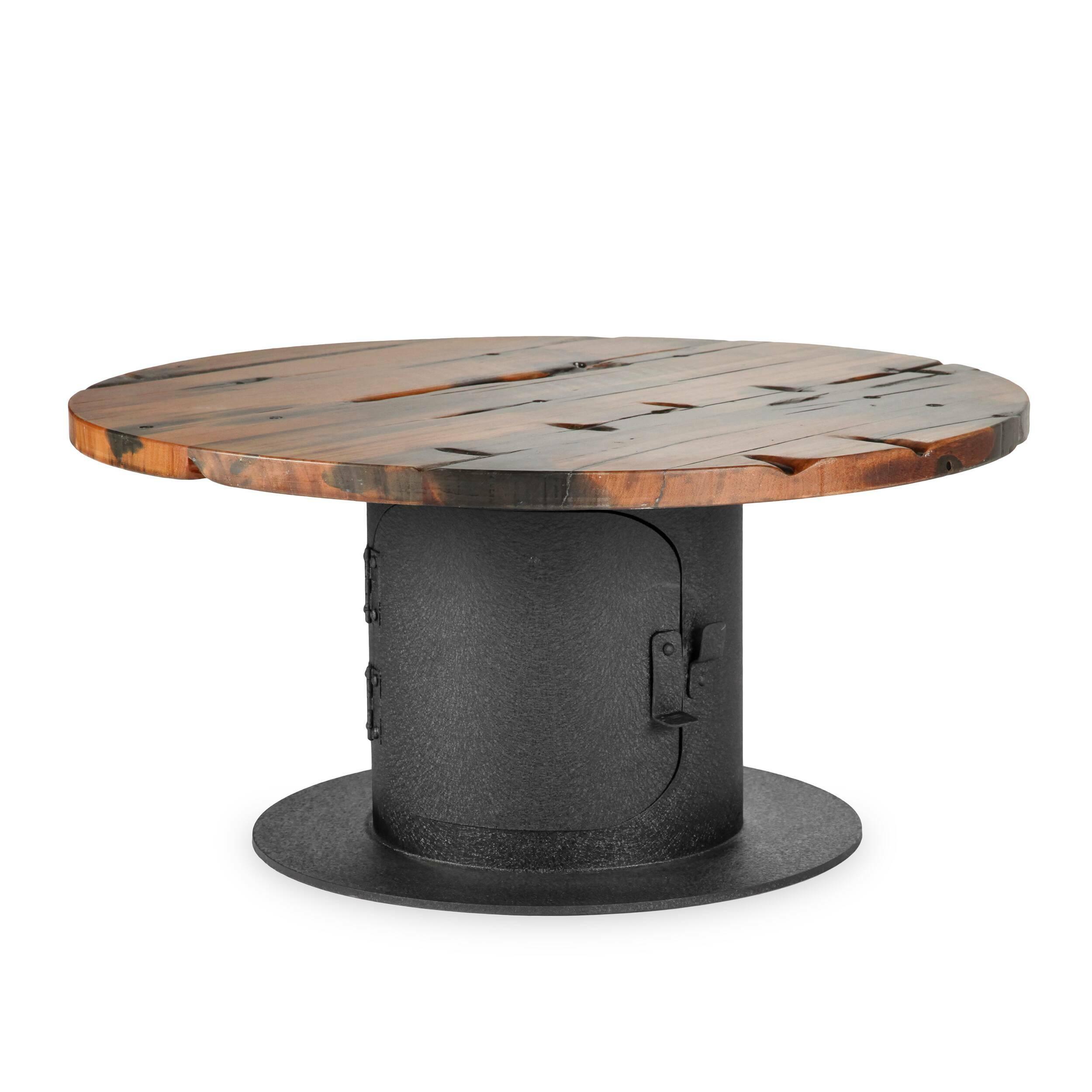 Кофейный стол StoveКофейные столики<br>Дизайнерский креативный кофейный стол Stove (Стоув) со столешницей из состаренного дерева от Cosmo (Космо).<br><br>Кофейный стол Stove обладает дизайном, который невероятно стильно смотрится в домашних интерьерах в стиле лофт, а также в кафе и барах. Необычная форма и стилизация изделия делают его по-настоящему запоминающимся элементом декора. Кажется, будто дизайнер придумал новое применение выведенным из эксплуатации фабричным механизмам. Ножка и столешница по форме напоминают катушку для каб...<br><br>stock: 0<br>Высота: 39<br>Диаметр: 80<br>Цвет ножек: Черный<br>Цвет столешницы: Коричневый<br>Материал столешницы: Массив состаренного дерева<br>Тип материала столешницы: Дерево<br>Тип материала ножек: Сталь