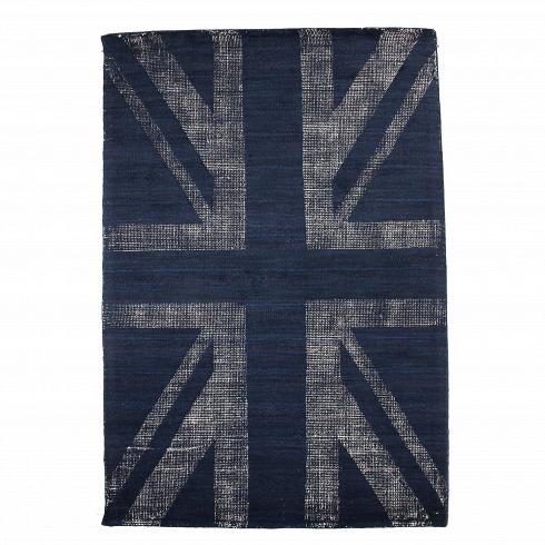 Ковер BuckinghamКовры<br>Принт, нанесенный на коверBuckingham, в особыхпредставлениях не нуждается. С помощью особой ковроткацкойтехники из цветного ворса выткан рисунок британского флага, все чаще являющийся популярным атрибутом современных интерьеров. Молодежь, которая определенно знает толк в современном дизайне, использует стилизованные флаги для декорирования стен, полов и мебели. Любой интерьер, где использовано изображение английского флага, приобретает дерзкую ноткуи оживляет его дизай...<br>