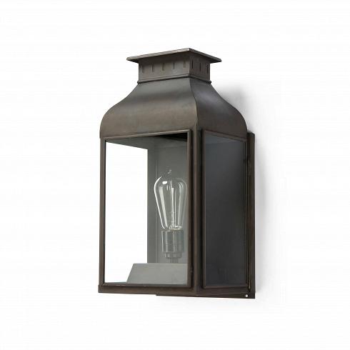 Настенный светильник LanternНастенные<br>Настенный светильник Lantern<br>эффектно выглядит и является отличным источником света, будь топрихожая, крыльцо или столовая.<br><br><br><br> Лаконичный дизайн ивыбор материалов (латунь, медь, алюминий, чугун) делают светильники фирмы Davey Lighting одинаково популярными ивостребованными как уприверженцев строгой классики, так иулюбителей современных форм.<br><br><br> Настенный светильник Lantern отлично подойдет как ксовременным, так икклассически...<br>