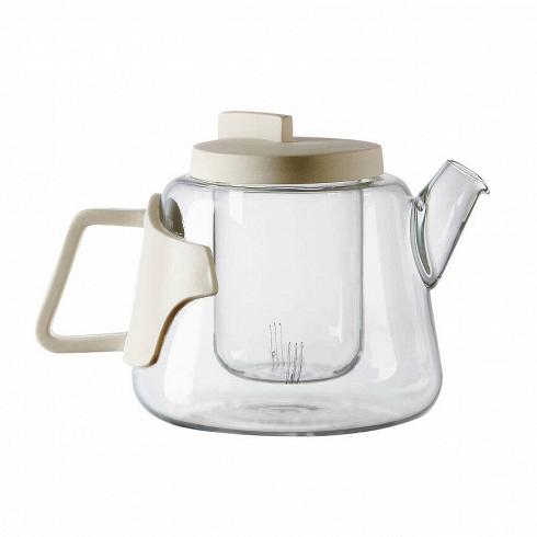 Чайник EraПосуда<br>Чайник Era представлен компанией Seletti. Прозрачное стекло позволяет насладиться насыщенным цветом кофе или чая, атонкий илегкий фарфор служит идеальным украшением изделия ипредотвращает нагревание ручки икрышки.<br><br><br> Чайник Era — часть коллекции, разработанной дизайнером Ким Хан Гю, который объединяет вместе в одном изделии два различных материала: боросиликатное стекло ифарфоровые ручки. Чайник идеально подходит для любой кухни, где каждый член сем...<br>