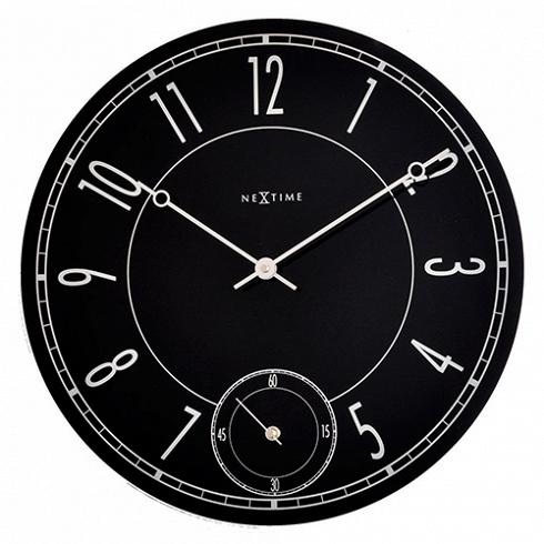 настенные часы LEITBRING (8144)Часы<br>Артикул: 8144. Черные стеклянные часы с оригинальным циферблатом – сочетание классики и модерна. Этот предмет интерьера напоминает увеличенную копию дорогих швейцарских часов, украшенных тонкими изящными стрелочками и снабженных практичным секундомером. Дизайн: Nextime, Нидерланды.<br>