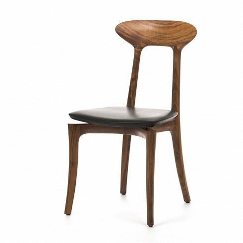 Стул Ma belleИнтерьерные<br>Стул Mabelle—интересный, даже диковинный дизайн в стиле скандинавский модерн. Эта разновидность модерна возникла в далекие тридцатые годы в Дании. Именно поэтому его часто называют датским. Направлению присущи особая элегантность и сдержанность, но наличие органичных сглаженных форм отсылают именно к модерну.<br><br><br><br> Стул Mabelle — каркас издревесины американского орехаимягкое сиденье вкожаной обивке.<br><br>DESIGNER: Roberto Lazzeroni