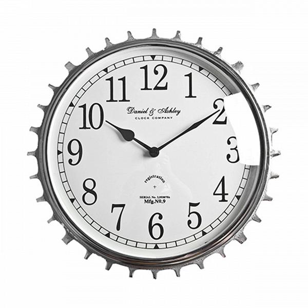 Часы (48-310-34)Часы<br>Дизайнерские настенные часы в форме шестеренки из металла и стекла от Roomers (Румерс).<br><br>stock: 10<br>Высота: 34<br>Ширина: 8<br>Материал: металл, стекло<br>Цвет: chrom<br>Длина: 34<br>Ширина: 8<br>Высота: 34<br>Длина: 34