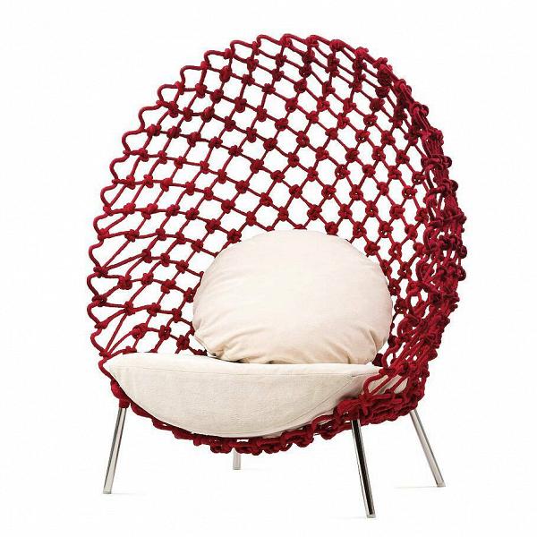 Кресло DragnetИнтерьерные<br>Дизайн интерьерного креслаВDragnet вдохновлен рыбацкими сетями —Втаким простым и, казалось бы, непривлекательным предметом. Однако этот источник вдохновения вылился в столь красивое и уникальное произведение дизайнерского искусства, которое не только подойдет к любому современному интерьеру, но и делают его привлекательным и эффектным.<br> <br> Изделие представляет собой стальную нержавеющую конструкцию, оплетенную хлопковым канатом, и мягкое сиденье с тканевой обивкой. Использованные в...<br><br>stock: 0<br>Высота: 136<br>Ширина: 110<br>Глубина: 86<br>Материал обивки: Хлопок<br>Цвет обивки дополнительный: Бежевый<br>Тип материала каркаса: Сталь нержавеющя<br>Тип материала обивки: Ткань<br>Цвет обивки: Красный<br>Цвет каркаса: Хром<br>Дизайнер: Kenneth Cobonpue