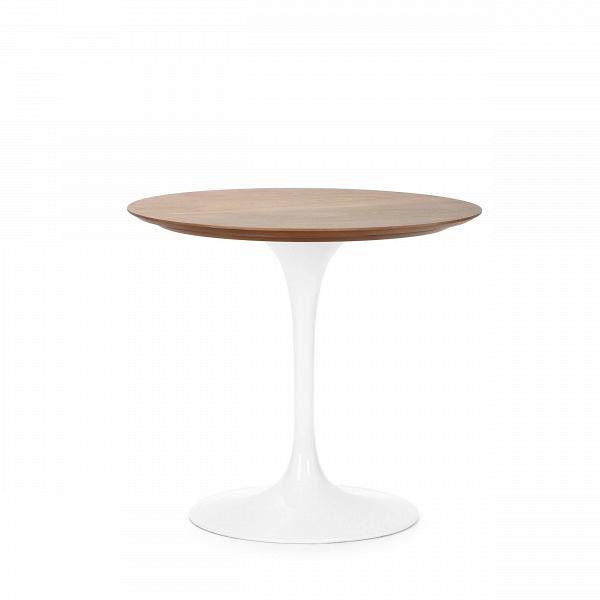 Обеденный стол Tulip с деревянной столешницей диаметр 80Обеденные<br>Дизайнерская обеденный круглый стол Tulip с деревянной столешницей диаметр 80 на тонкой глянцевой ножке от Cosmo (Космо).<br>         УВкаждого знаменитого дизайнера прошлого столетия есть своя «формула вечного дизайна», аВзначит есть иВпроизведения дизайнерского искусства, которые уже много лет неВвыходят изВмоды, неВтеряют своей актуальности иВвостребованы поВсей день.<br><br><br> Стол Tulip как раз был разработан при помощи такой формулы, которую вывел Ээро ...<br><br>stock: 4<br>Высота: 72<br>Диаметр: 80<br>Цвет ножек: Белый глянец<br>Цвет столешницы: Орех американский<br>Материал столешницы: Фанера, шпон ореха<br>Тип материала столешницы: Фанера<br>Тип материала ножек: Алюминий<br>Дизайнер: Eero Saarinen