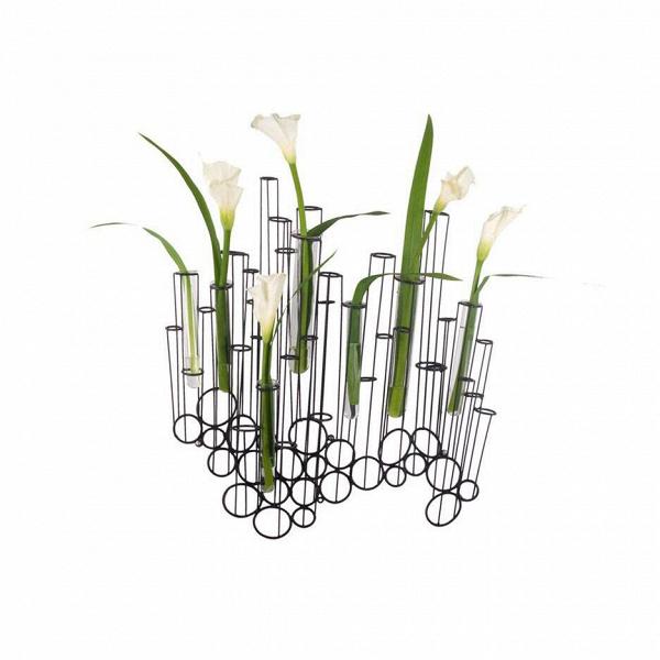 Настенная ваза CrokkisВазы<br>Настенная ваза Crokkis<br>создает впечатление, что ваши цветы просто парят вВвоздухе. Она состоит изВстеклянных пробирок, закрепленных вВметаллическом каркасе. Трубки могут быть заполнены водой, цветами или любым другим декоративным материалом. Обладатель настенной вазы Crokkis сам заканчивает процесс создания этого продукта, непосредственно участвуя в нем как дизайнер.<br><br><br><br> «Металлические провода искривлены иВсварены таким образом, чтобы напомнить эскизы отВрук...<br><br>stock: 0<br>Цвет: Черный<br>Состав основы: Металл<br>Дизайнер: Kenneth Cobonpue