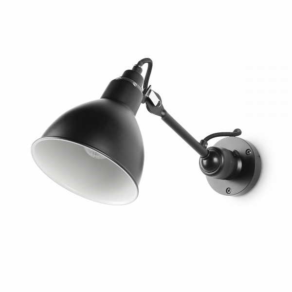 Настенный светильник BronxНастенные<br>Настенный светильник Bronx — прекрасный представитель коллекции дизайнерских светильников Bronx. Этот элемент интерьера представляет собой воплощение стиля модерн, ставшего чрезвычайно популярным в XX веке.<br><br><br> Изначально настенный светильник Bronx был предназначен для промышленного применения. Он был сделан прочно, но просто: никелированный абажур, стальные трубки каркаса, шарнирные соединения — и ни одного сварочного шва. Отсутствие вычурности и чистота линий, иначе говоря лаконичност...<br><br>stock: 29<br>Высота: 18<br>Ширина: 20<br>Диаметр: 14<br>Количество ламп: 1<br>Материал абажура: Алюминий<br>Материал арматуры: Сталь<br>Мощность лампы: 40<br>Ламп в комплекте: Нет<br>Напряжение: 220-240<br>Тип лампы/цоколь: E14<br>Цвет абажура: Черный<br>Цвет арматуры: Черный<br>Цвет провода: Черный