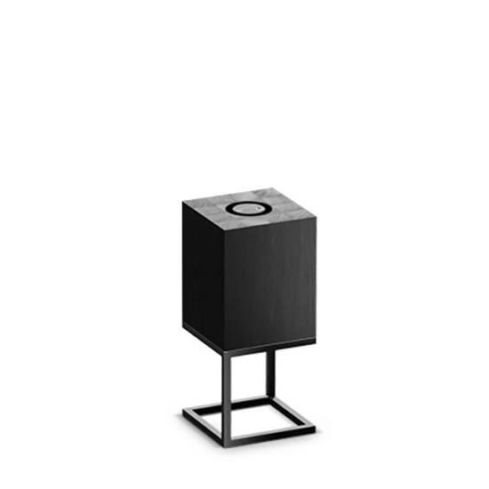 Настольный светильник Cubх S, NoirНастольные<br>Настольный светильник Cubх S, Noir самый компактный светильник серии Cubx. Как и все светильники Handy, настольный светильник Cubх S, Noir оснащен светодиодами отличного качества, яркость которых можно варьировать от декоративной ночной подсветки до очень яркого источника дополнительного освещения. Управление яркостью осуществляется переносным деревянным пультом, который примагничивается к корпусу светильника в специальной нише сверху. Пульт можно достать и управлять светильником дистанционно...<br><br>stock: 0<br>Высота: 45<br>Ширина: 20<br>Длина: 20<br>Длина провода: 300<br>Количество ламп: 1<br>Материал абажура: Дерево<br>Материал арматуры: Металл<br>Мощность лампы: 12<br>Ламп в комплекте: Да<br>Напряжение: 220<br>Степень защиты: 40<br>Теплота света: 3000<br>Тип лампы/цоколь: E27<br>Цвет абажура: Черный<br>Цвет арматуры: Черный<br>Цвет провода: Черный