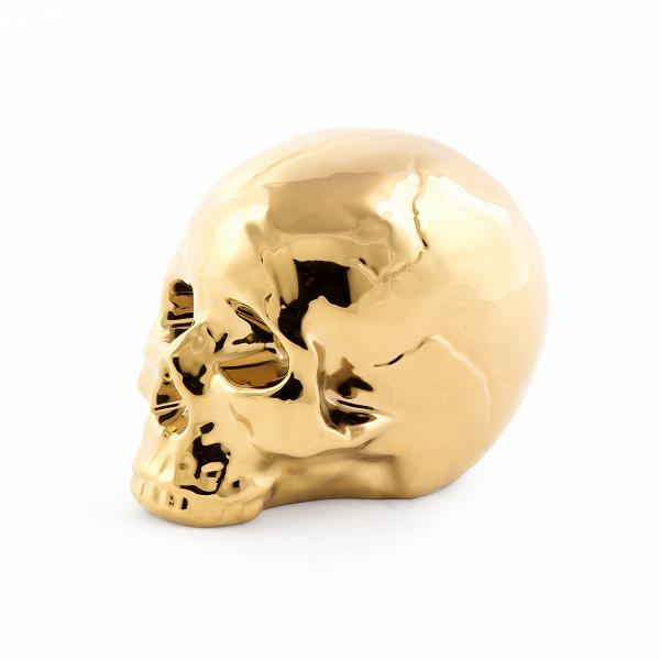 Фарфоровый череп MemorabiliaНастольные<br>Дизайнерская фарфоровая статуэтка Memorabilia (Меморабилия) в форме черепа от Seletti (Селетти).<br><br><br> Дизайнерский фарфоровый череп Memorabilia изготовлен изВвысококачественного фарфора. Доступны две конфигурации данного изделияВ— вВзолотом иВбелом цвете. Череп изВколлекции Memorabilia был создан талантливыми дизайнерами компании Seletti. Данный бренд вот уже несколько лет славится экстраординарным иВсмелым взглядом наВдизайн предметов интерьера.<br><br><br><br>...<br><br>stock: 8<br>Высота: 15<br>Ширина: 14<br>Материал: Фарфор<br>Цвет: Золотой/Gold<br>Длина: 25