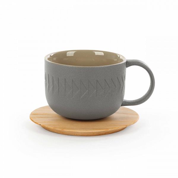 Чашка с блюдцем Tactile диаметр 9,4Посуда<br>Коллекция Tactile сочетает в себе черты скандинавского минимализма и яркую геометрию японского стиля. Изделия этой коллекции отличаются необыкновенной красотой пропорций и аккуратного, «тактильного» узора. Все модели выполнены в завораживающих шоколадных оттенках.<br><br><br> Коллекция Tactile включает в себя изящные модели тарелок и мисок, вазы, чашки и другие принадлежности, способные украсить собой любой обеденный стол. Внутренняя полость сосудов идеально гладкая и очень красиво сочетается с ...<br><br>stock: 87<br>Высота: 7,1<br>Материал: Глина<br>Цвет: Темно-серый<br>Диаметр: 9,4