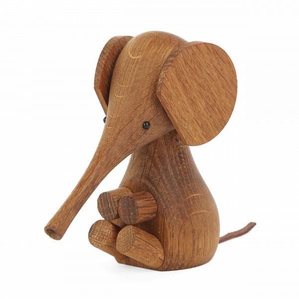 Статуэтка Baby ElephantНастольные<br>Дизайнерские декоративные элементы делают домашний интерьер неповторимым, интересным и, главное, эстетически привлекательным. А такой очаровательный слоненок станет не просто замечательным украшением для домашней обстановки, но и дополнит ее мягкими чертами и очаровательной детской непосредственностью. Дизайнерская статуэтка Baby Elephant (Слоненок) создаст хорошее настроение у всех окружающих.<br><br><br> Слоник изготавливается из высококачественной древесины дуба. Материал с древних времен изв...<br><br>stock: 20<br>Высота: 11<br>Материал: Массив дуба<br>Цвет: Темно-коричневый