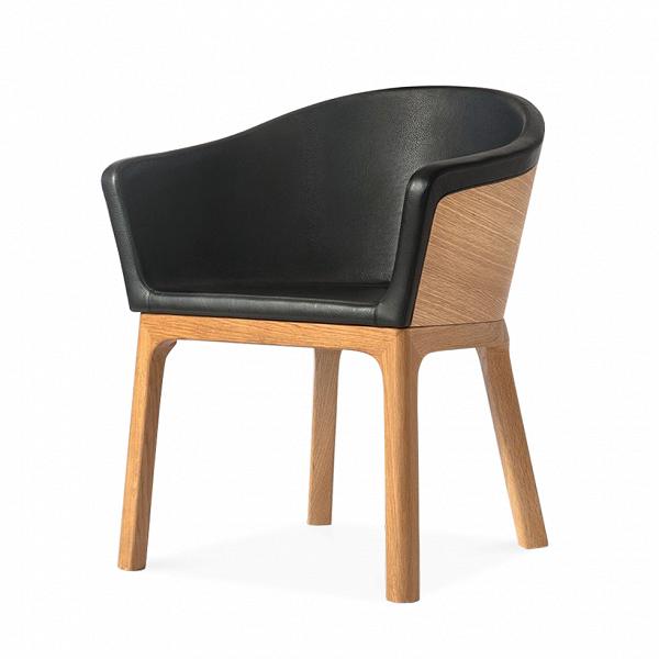 Кресло PalettaИнтерьерные<br>Дизайнерское легкое кресло Paletta (Палетта) на длинных деревянных ножках с закругленной спинкой от Cosmo (Космо).<br><br><br> Мастер функционального дизайна Шон Дикс делает универсальную мебель, которую можно поставить в любом пространстве, будь то небольшая уютная гостиная, шикарное лобби отеля или строгая приемная в офисе. Вот и свое кресло Paletta («кресло-ложечку», именно так с итальянского переводится название) он придумал в качестве идеального предмета мебели дляВлюбого интерьера.<br><br>...<br><br>stock: 0<br>Высота: 74,5<br>Высота сиденья: 45<br>Ширина: 62<br>Глубина: 57,5<br>Цвет ножек: Дуб<br>Материал каркаса: Фанера, шпон дуба<br>Материал ножек: Массив дуба<br>Тип материала каркаса: Фанера<br>Коллекция ткани: Harry Leather<br>Тип материала обивки: Кожа<br>Тип материала ножек: Дерево<br>Цвет обивки: Черный<br>Цвет каркаса: Дуб<br>Дизайнер: Sean Dix