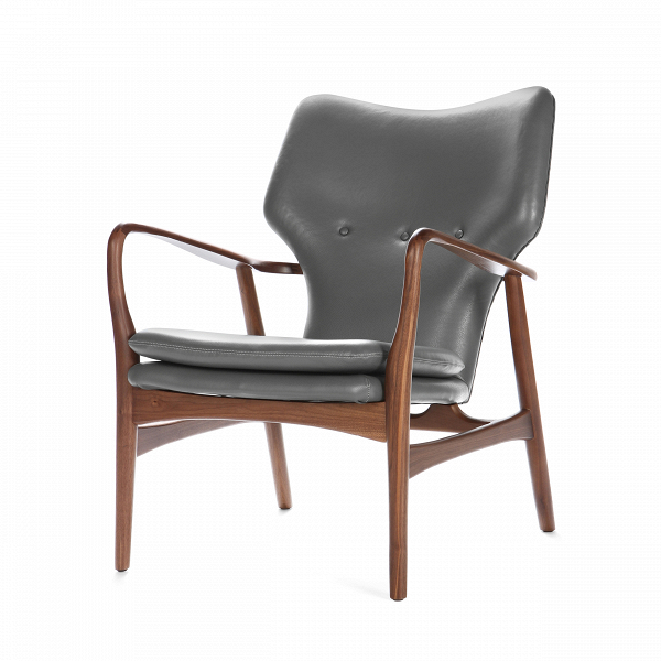 Кресло SimonИнтерьерные<br>Дизайнерское глубокое кресло Simon (Саймон) с каркасом из дерева от Cosmo (Космо).<br><br>Кресло Simon<br>— результат работы скандинавских проектировщиков, подаренный современному придирчивому потребителю, ценящему высокий уровень. Стиль этого невероятноВпрактичного кресла — отпечаток многовековой истории в области дизайна и интерьера. Изящные линии подлокотников, сглаженные углы сиденья и ножек кресла — словно пища для глаз! Несомненно, с этим высказыванием согласятся все приверженцы натура...<br><br>stock: 0<br>Высота: 85,5<br>Высота сиденья: 44<br>Ширина: 68,5<br>Глубина: 76<br>Материал каркаса: Массив ореха<br>Тип материала каркаса: Дерево<br>Коллекция ткани: Harry Leather<br>Тип материала обивки: Кожа<br>Цвет обивки: Темно-серый<br>Цвет каркаса: Орех американский<br>Дизайнер: Finn Juhl