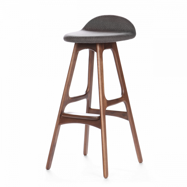 Барный стул Buch 3Барные<br>Дизайнерский барный стул Buch (Буш) без подлокотников на деревянных ножках от Cosmo (Космо).<br> Высокий барный стул Buch 3 создан еще вВ1960 году дизайнером Эриком Буком, который посвятил всю свою жизнь дизайну и архитектуре. У Эрика Бука было свыше 30 коммерчески успешных дизайн-проектов, среди которых самым успешным стал именно этот барный стул, который нашел свое место в миллионах домов по всему миру. Сегодня же стулья, сконструированные Эриком Буком, по-прежнему производятся на фабри...<br><br>stock: 8<br>Высота: 85,5<br>Высота сиденья: 75<br>Ширина: 40<br>Глубина: 45<br>Цвет ножек: Орех<br>Материал ножек: Массив ореха<br>Материал сидения: Полиэстер<br>Цвет сидения: Темно-серый<br>Тип материала сидения: Ткань<br>Коллекция ткани: Gabriel Fabric<br>Тип материала ножек: Дерево<br>Дизайнер: Erik Buch